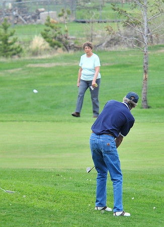 Walt Hester | Trail Gazette<br /> A golfer pitches his ball up onto the green on the Lake Estes Nine-Hole Course on Wednesday. Warm temperatures and overcast skies made for comfortable play in Estes Park on Wednesday.