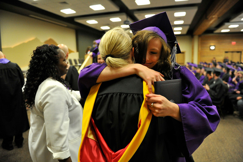 Walt Hester | Trail Gazette<br /> Graduate Brittany Walters hugs everyone in line before heading back to her seat during Friday's graduation ceremony at the YMCA of the Rockies.