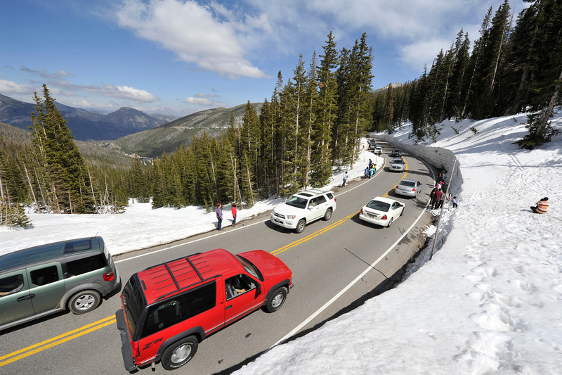 Walt Hester | Trail Gazette<br /> Visitors pack Trail Ridge Road as it bends around the upper reaches of Hidden Valley on Sunday. The Memorial Day weekend drew a surge of visitors into the park to see the record snowpack.