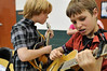 Walt Hester | Trail Gazette<br /> Finn Tierney, 12, right, and Will Thomas, 10, tune up before their performance at the Estes Park Elementary School's annual talent show. Children from third through fifth grade performed many talents such as dancing, singing, hula-hooping and playing guitars, mandolins and pianos for the show.