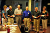 Walt Hester | Trail Gazette<br /> Julie -------, far left, and Richard Homeier, center, hand out checks from the Longs Peak Rotary Club on Wednesday. Mike Richardson for the Youth Center received $1,000. Chuck Varilek received $450 for the R3 School District's band program. Gary Brown received $250 for the Honor Flight. Nancy Almond received $250 for EVICS.