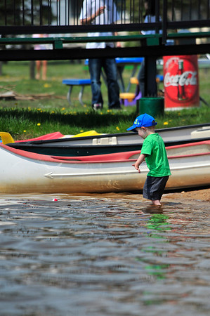 Walt Hester | Trail Gazette<br /> Collin Bennett, 3, of Arvada braves the cold water and wades into Lake Estes on Saturday. The cold water was welcomed relief as summer temperature descend on Colorado.
