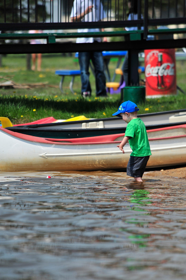 Walt Hester   Trail Gazette<br /> Collin Bennett, 3, of Arvada braves the cold water and wades into Lake Estes on Saturday. The cold water was welcomed relief as summer temperature descend on Colorado.