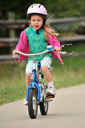Walt Hester   Trail Gazette<br /> Claire Reed, 5, cruises the Lake Estes Trail on Wednesday. Users of the trail are asked to keep an eye out for elk, as it is calving season.