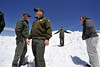 Walt Hester | Trail Gazette<br /> National park officials marvel at the unprecedented amount of snow sitting behind the Alpine Visitors Center on Friday. The unusual amount of snow has led to the latest opening of Trail Ridge Road in a generation.