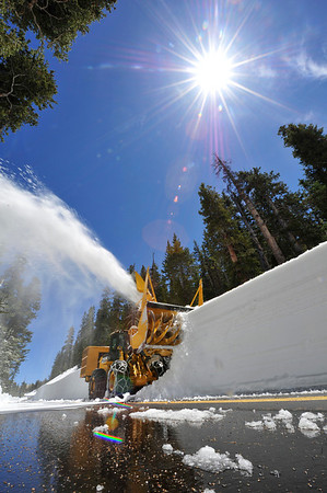 Walt Hester | Trail Gazette<br /> A park rotary plow clears snow along Trail Ridge Road below Medicine Bow Curve on Friday. Park officials hope to open the road on Friday, June 10, the latest the road has opened in the last 20 years.