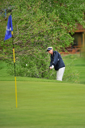 Walt Hester   Trail Gazette<br /> A golfer hips onto the green at the Lake Estes 9-Hole golf course on Wednesday.