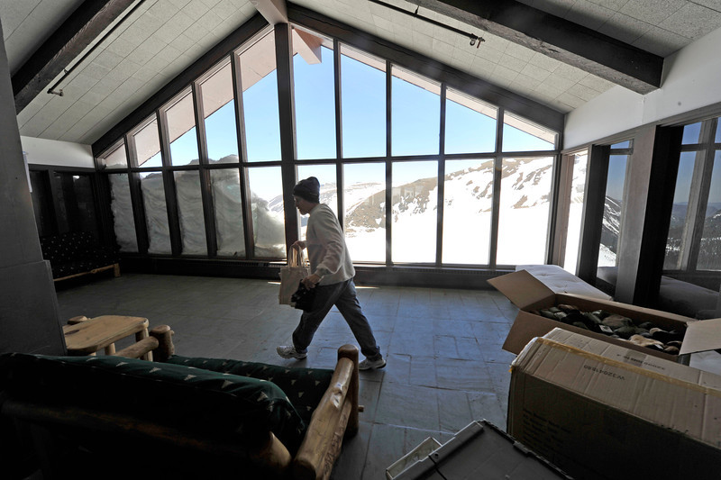 Walt Hester | Trail Gazette<br /> Scott Ashton helps set up the national park's Alpine Visitors Center on Friday. The unusual snowpack created a drift abscuring the view of the Fall River drainage.
