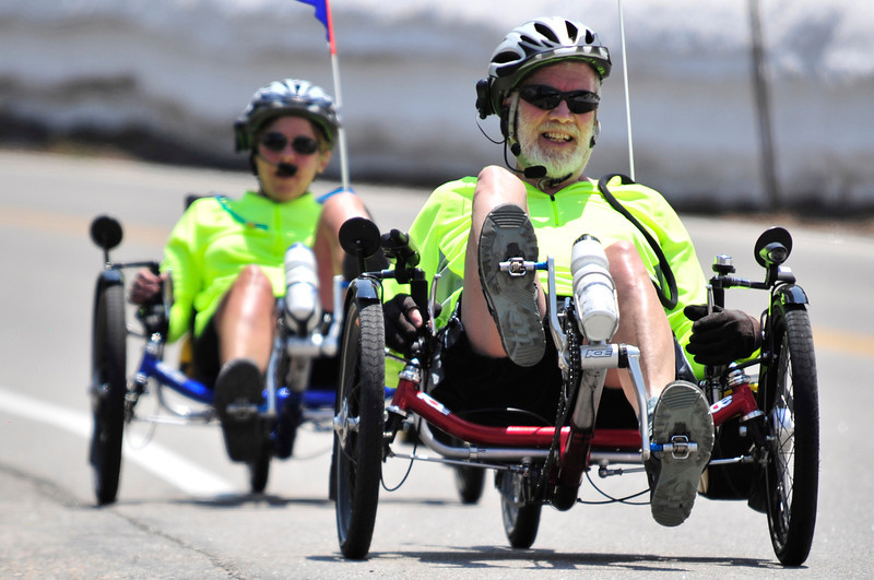 Walt Hester | Trail Gazette<br /> Stan and Margaret Huntting of Allenspark pedal up Trail Ridge Road on recumbent tricycles on Monday. Cyclists are answering the clarion call of the mountains now that temperatures are on the rise and Trail Ridge Road is open.