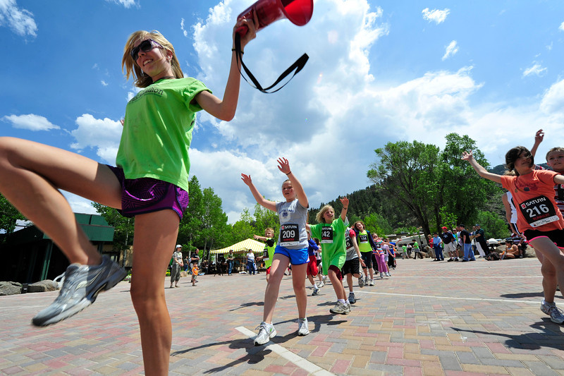 Walt Hester | Trail Gazette<br /> Sara Speedlin of Estes park helps warm up the young runners before the Kids Fun Runs on Saturday. Children were separated into age grtoups, and each group ran a different distance for the event.