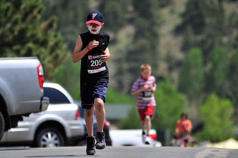 Walt Hester | Trail Gazette<br /> Cole Egr, 11, of Yutan, Nebr., leads his age group up MacGregor Avenue on Saturday during the kids races leading up to Sunday's Estes Park Marathon.