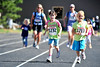 Walt Hester | Trail Gazette<br /> Sydney Lewellind, 7, and Janna Coop, 8, approach the finish line with family close behind on Sunday. While the Kids Runs were Saturday, many children ran with family for the 5K and 10K races.