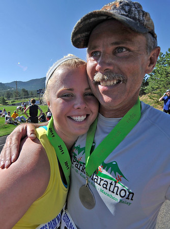 Walt Hester | Trail Gazette<br /> Krista, 18, and Don Klebenow of Elko, Nev., enjoy a hug after Sunday's half-marathon. Krista asked her father to run the race with her as a high school graduation present.