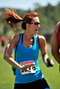 Walt Hester | Trail Gazette<br /> Becky Hamm of Boulder is overtaken by the music at the finish line of Sunday's races. Runners were treated to food, drinks, massage and a festive atmosphere at Bobcat Stadium.