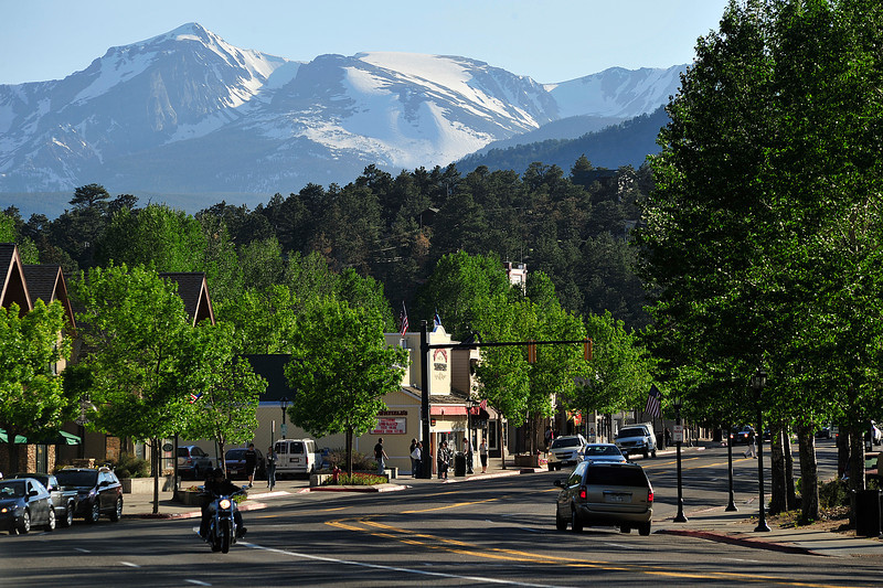 Walt Hester | Trail Gazette<br /> Early evening sun casts long shadows over mountains and streets in Estes Park on Tuesday.