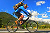 Walt Hester | Trail Gazette<br /> Jim Belcer of Estes Park pedals past Longs Peak on Moraine Avenue on his way to Fern Lake on Tuesday. The national park has reported a substantial dip in visitation.