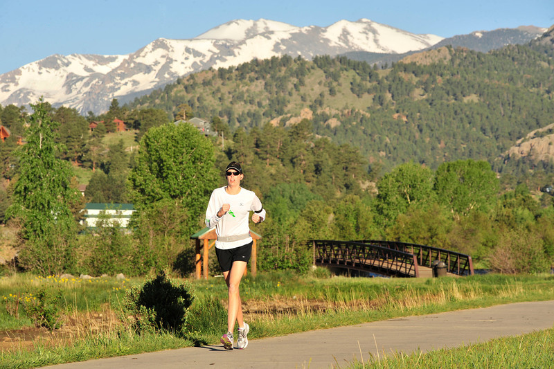 Walt Hester | Trail Gazette<br /> A runner starts her day on the Lake Estes Trail on Wednesday. Outdoor enthusiasts will have plenty of chances to play, as weekend weather should be warm and mostly sunny.