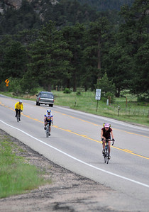 Walt Hester | Trail Gazette Riders plunge down HWY 7 into Estes Park on Sunday. The tour began and will end in Gilpin County, near Central City.