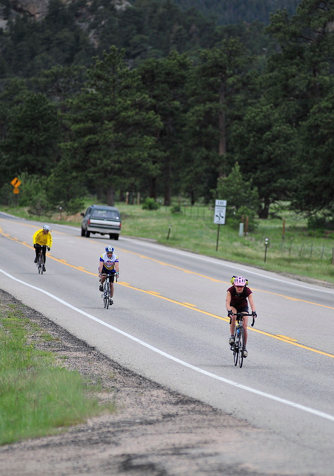 Walt Hester | Trail Gazette<br /> Riders plunge down HWY 7 into Estes Park on Sunday. The tour began and will end in Gilpin County, near Central City.