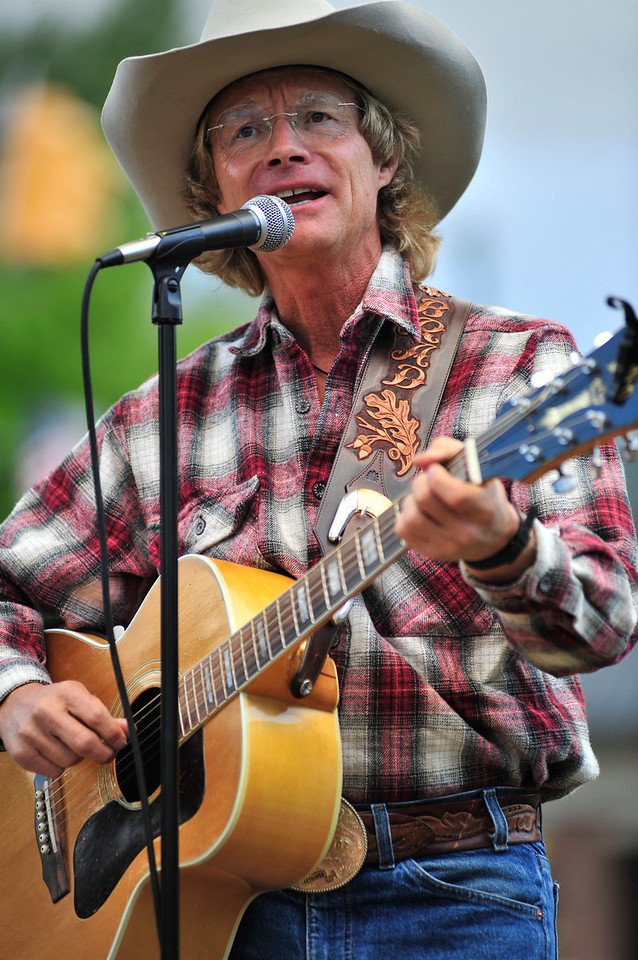 Walt Hester | Trail Gazette<br /> Coyboy Brad Fitch performs on Monday night in Bond Park.