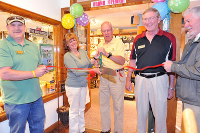 Walt Hester | Trail Gazette Estes Park mayor Bill Pinkham and Mad Moose owner Holly Moore cut the ribbon officially opening the Mad Moose Home and Garden in the Park Place Mall on Friday. Also pictured are, from left, Mayor Pro-Tem Chuck Levine, town trustee Eric Blackhurst and town trustee Mark Elrod.