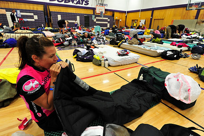 Walt Hester | Trail Gazette Christy Mougin of Denver inflates her bed for Sunday night in the Estes Park High School's gym. Riders can find their own rooms, camp outside, or find a space inside on the tour.