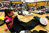 Walt Hester | Trail Gazette<br /> Christy Mougin of Denver inflates her bed for Sunday night in the Estes Park High School's gym. Riders can find their own rooms, camp outside, or find a space inside on the tour.