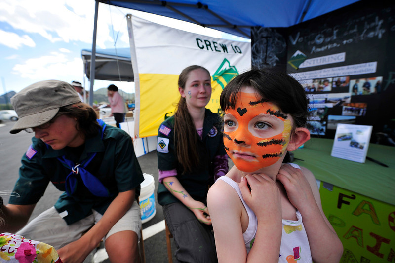 Walt Hester | Trail Gazette<br /> Haniah Ludlam, 6, of Ests Park shows off her new stripes at te Estes Valley Farmers' Market on Thursday. Estes Park's Venturing Crew 10 will be painting faces at the market through the summer to fund projects, including sending crew members to Costa Rica to save green sea turtles.