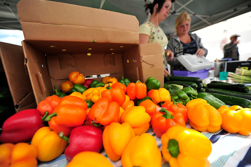 Walt Hester | Trail Gazette<br /> Alexa Morris of Milliken, Colo., and Jen Miller, 17, of Platteville sell colorful bell peppers for Miller Farms at the Estes Valley Farmers' Market on Thursday. As the summer progresses, more vendors with more and different wares are attending the market.