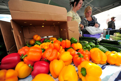Walt Hester | Trail Gazette Alexa Morris of Milliken, Colo., and Jen Miller, 17, of Platteville sell colorful bell peppers for Miller Farms at the Estes Valley Farmers' Market on Thursday. As the summer progresses, more vendors with more and different wares are attending the market.