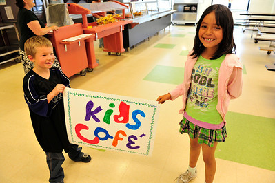 Walt Hester | Trail Gazette Payton Zelle, 7, and Danna Lujan, 8, hold the sign anouncing the Kid's Cafe at the Estes Parl Elementary School on Tuesday.