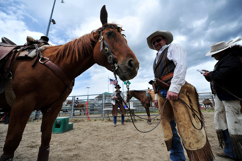 Walt Hester | Trail Gazette<br /> George Harty of Lusk, Wyo., stands after his run at the Cowboy Mounted Shooting Show at the Stanley Fair Grounds on Saturday. The event showcased the riders skills of shooting targets from horseback.