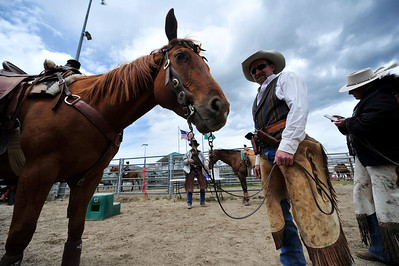 Walt Hester | Trail Gazette George Harty of Lusk, Wyo., stands after his run at the Cowboy Mounted Shooting Show at the Stanley Fair Grounds on Saturday. The event showcased the riders skills of shooting targets from horseback.