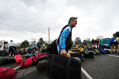 Walt Hester | Trail Gazette Estes Park's Bill Murry picks up his luggage for the day before finding his tent on Sunday. The Tour of Colorado transports riders' luggage from one stop to the next each day.