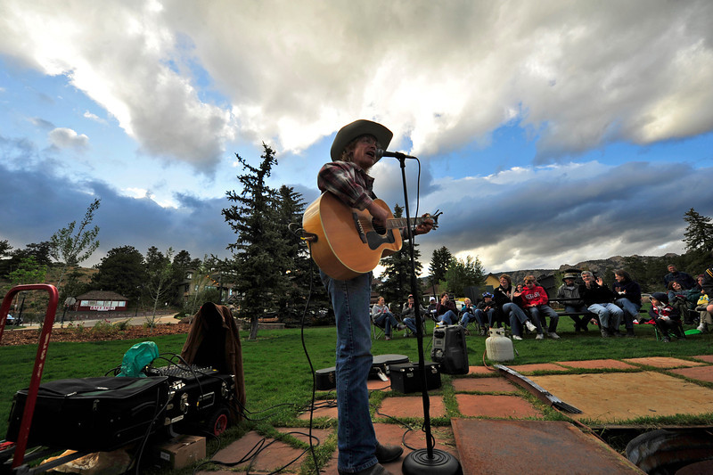 Walt Hester | Trail Gazette<br /> Cowboy Brad Fitch sings to the crowd in Bond Park on Monday. The summer Cowboy Sing-Along runs through August.