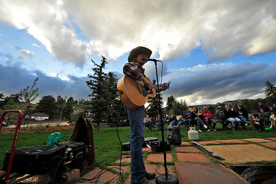Walt Hester | Trail Gazette Cowboy Brad Fitch sings to the crowd in Bond Park on Monday. The summer Cowboy Sing-Along runs through August.