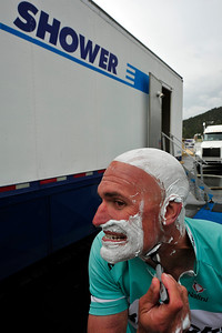 Walt Hester | Trail Gazette Kevin Lockhart of Santa Clarita, Calif., shaves at a mobile shower set up for the tour. Each day, the tour moves the comforts of a small town from one stop to the next.