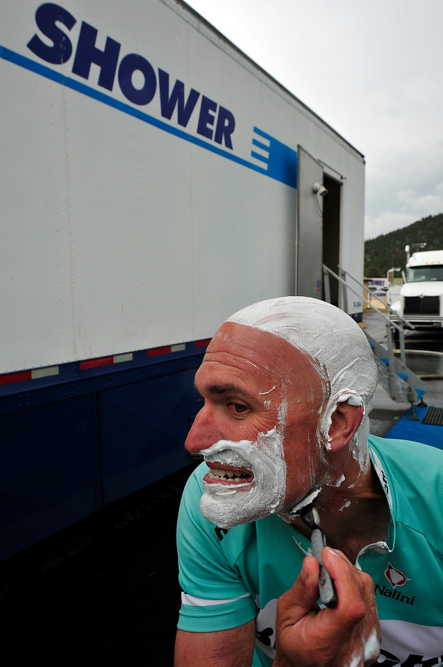 Walt Hester | Trail Gazette<br /> Kevin Lockhart of Santa Clarita, Calif., shaves at a mobile shower set up for the tour. Each day, the tour moves the comforts of a small town from one stop to the next.