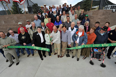 Walt Hester | Trail Gazette Mayor Bill Pinkham and a large cast of supporters of the new Fairgrounds Parkand Ride cut the ribbon officially opening the facility on Friday. Town, county, state and federal officials made the trip to Estes Park for the opening of the transit hub that shoud alleviate some of the town's summer congestion.