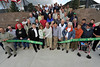 Walt Hester | Trail Gazette<br /> Mayor Bill Pinkham and a large cast of supporters of the new Fairgrounds Parkand Ride cut the ribbon officially opening the facility on Friday. Town, county, state and federal officials made the trip to Estes Park for the opening of the transit hub that shoud alleviate some of the town's summer congestion.