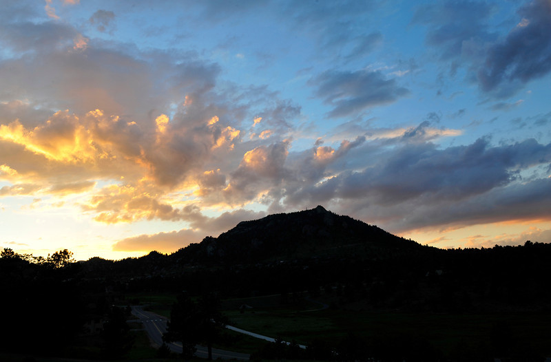 Walt Hester | Trail Gazette<br /> Another stunning sunset sends Estes Park to bed on Friday, July 1. Afternoon storms often lead to spectacular sunsets in the Rockies.