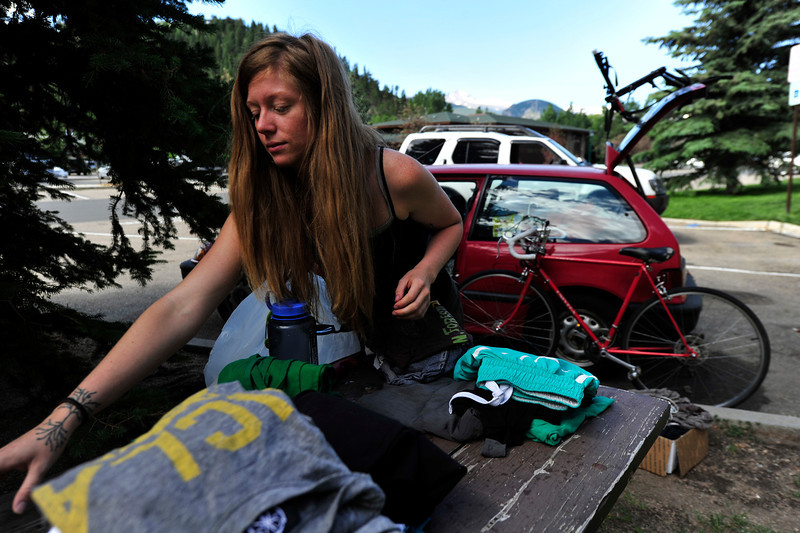 Walt Hester | Trail Gazette<br /> Sarah Penrod of Chicago sorts laundry on a picnic table on Sunday morning. The young climber hopes to spend her summer exploring the rocks and routes around Estes Park.