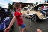 Walt Hester | Trail Gazette<br /> Five-year-old Kaitlyn Parr of Colorado Springs dances between cars at the car show on Monday. The Independence Day events attract a large number of families who spend all day, if not the entire weekend, in Estes Park.