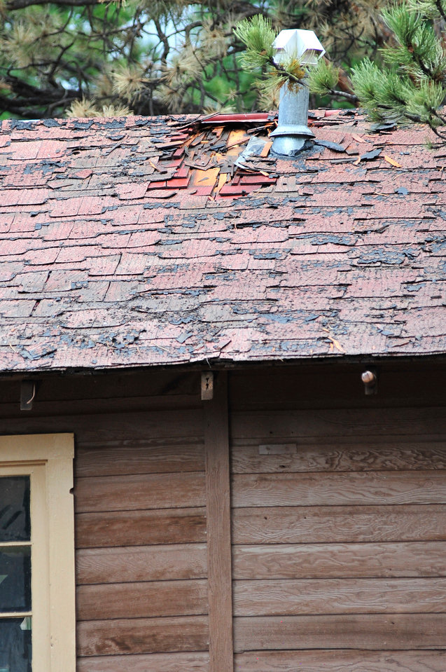 Walt Hester | Trail Gazette<br /> The roof of the Linden storage building at the YMCA of the Rockies shows damage from a Wednesday fire. Lightning reportedly struck the metal vents, but firefighters were able to quickly douse the flames.