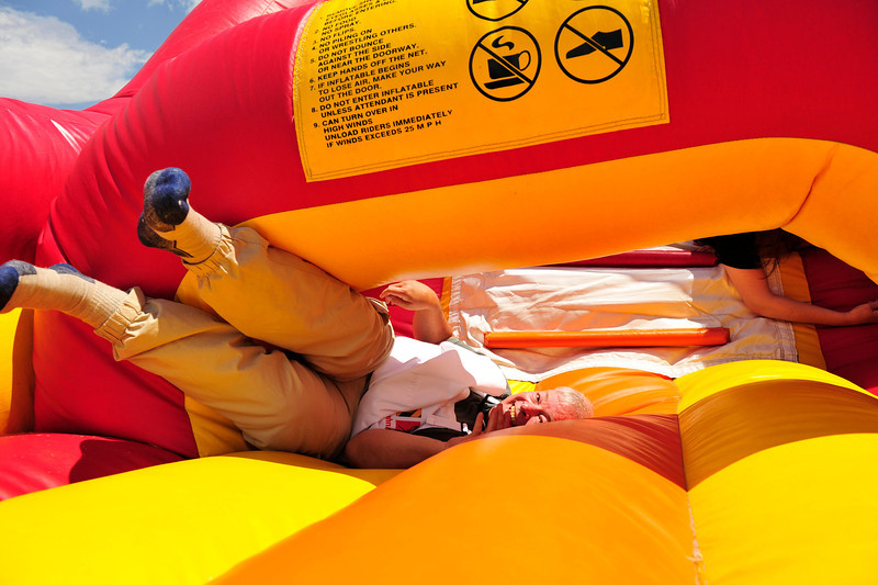Walt Hester | Trail Gazette<br /> Doctor Richard Beesley embraces his inner child at the annual New Life Center picnic in Stanley Park on Saturday. The event celebrates all of the people born in the Estes Park Medical Center since 1975.