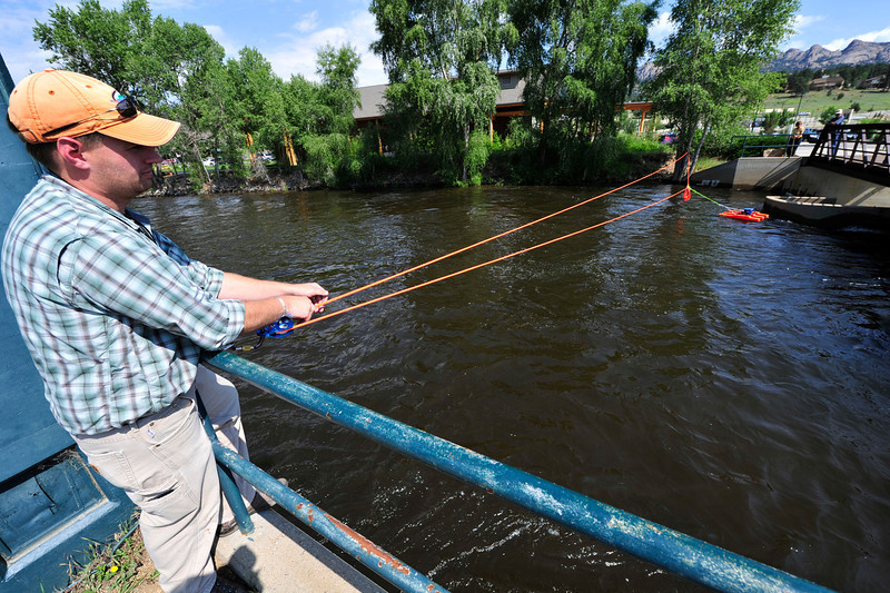 Walt Hester | Trail Gazette<br /> Russell Stroud of the Colorado Division of Water Rescorces measures the flow of the Big Thompson River on Wednesday morning. Stroud believes the worst is over, with spring runoff peaking on July 1.