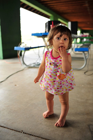 Walt Hester | Trail Gazette<br /> Adriana Hess, 1, toddles about the New Life Center's annual picnic on Saturday. The event celebrates all of the babies born in Estes Park since 1975.