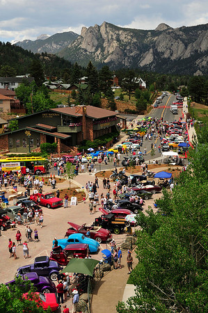 Walt Hester | Trail Gazette<br /> Colorful cars and visitors line MacGergor Avenue on Monday. The annual Collest Car Show draws enthusiasts to Estes Park from all over Colorado and surrounding states.