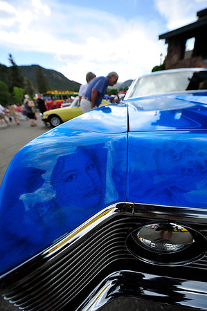 Walt Hester | Trail Gazette<br /> The face of Gina Strain stares out from the paint of a 1971 Mercury Monterey. Gina and Phil Strain of Lakewood also have faces of daughters worked into the classic car's paint job.
