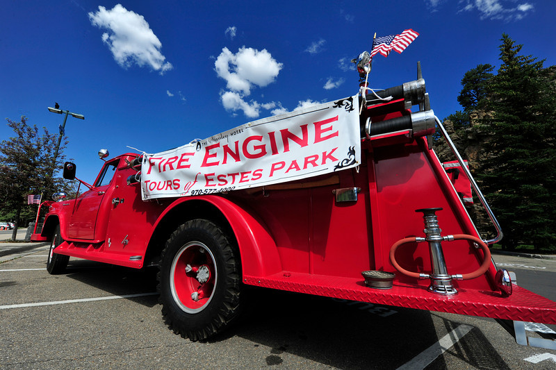 Walt Hester | Trail Gazette<br /> A banner on a classic fire truck advertises tours on Sunday morning. The Stanley Hotel used the trucks to carry visitors to historic locations around Estes Park, such as the old hydro-electric plant.